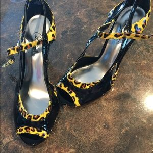 Shoes - Black and yellow animal print heels